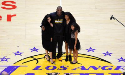 Photo of Los Angeles Lakers' Kobe Bryant poses for pictures with his wife Vanessa, left, and daughters Natalia, second from right, and Gianna