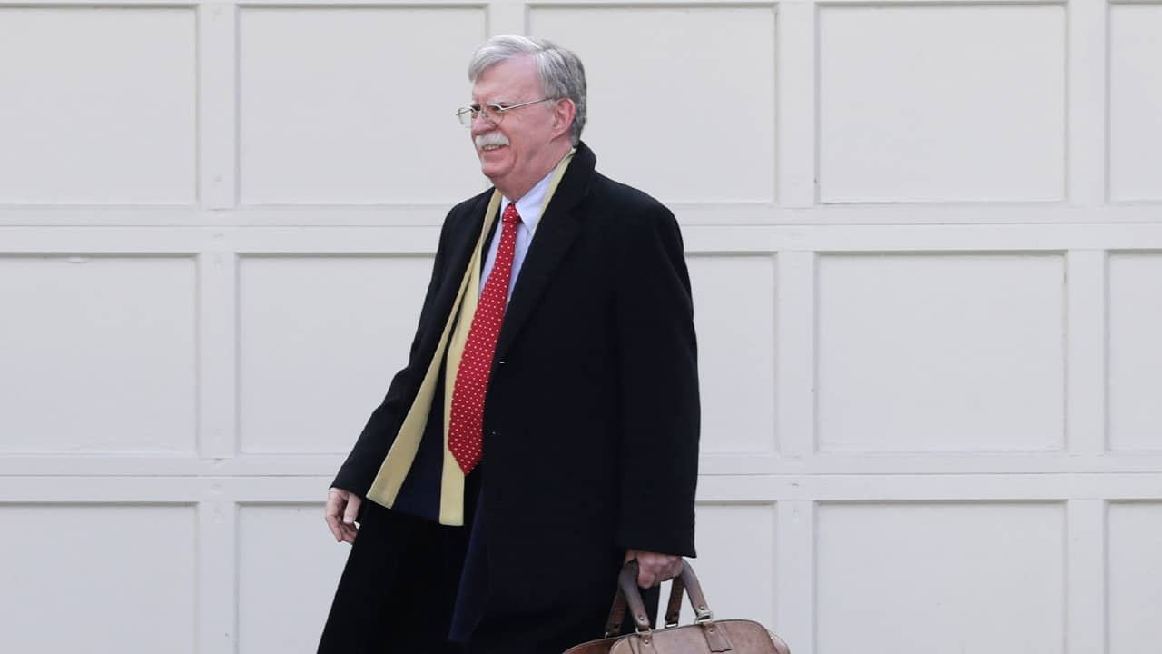 Photo of John Bolton leaving his house