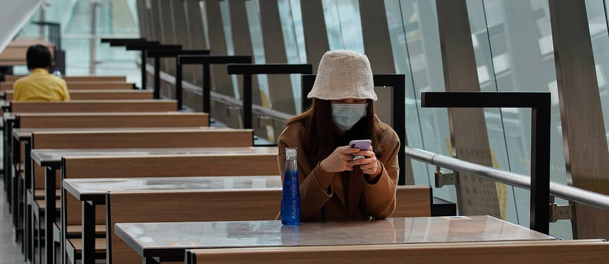 Photo of a woman wearing a protective face mask at the high speed train station in Hong Kong