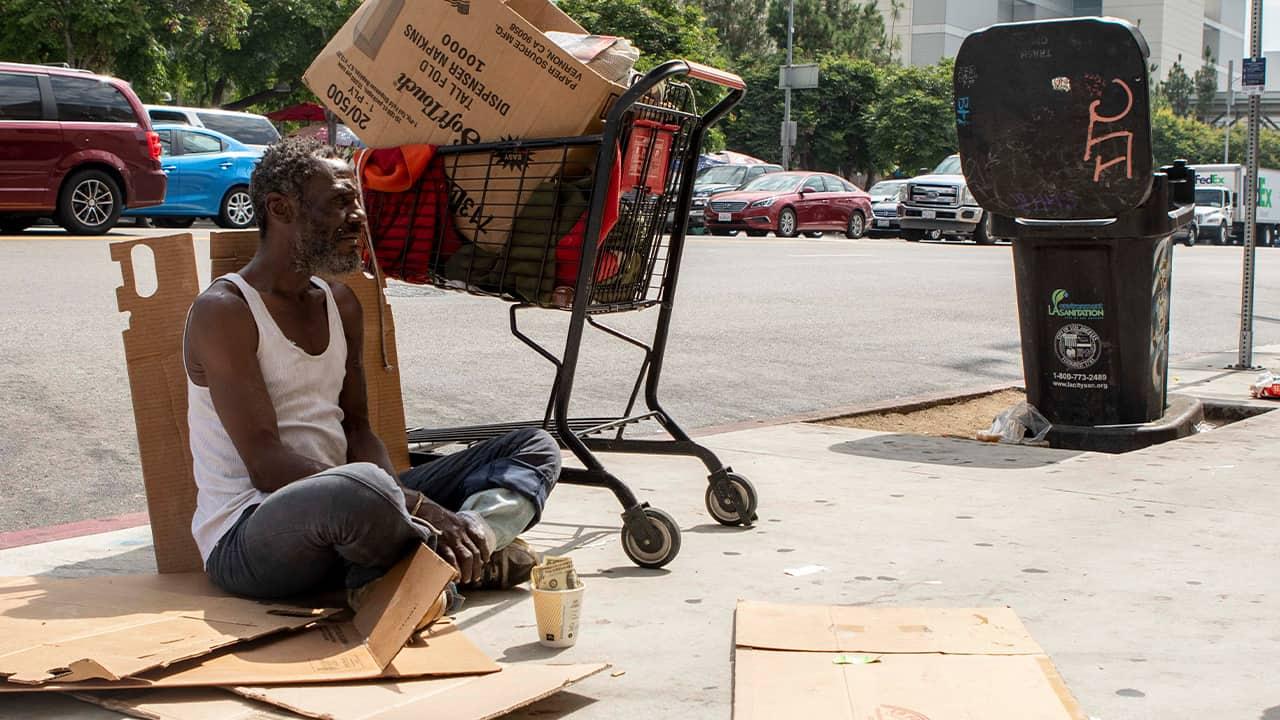 Photo of Will panhandling on the sidewalk