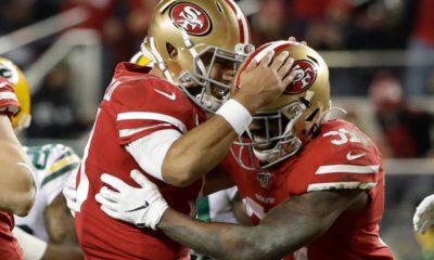 Photo of San Francisco 49ers running back Raheem Mostert and quarterback Jimmy Garoppolo