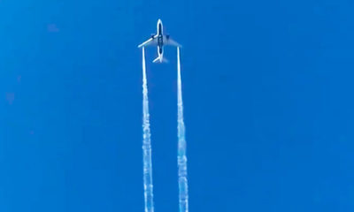 Photo of a plane flying in the sky