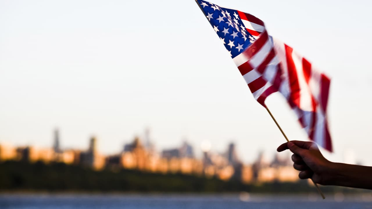 Photo of a person holding an American flag