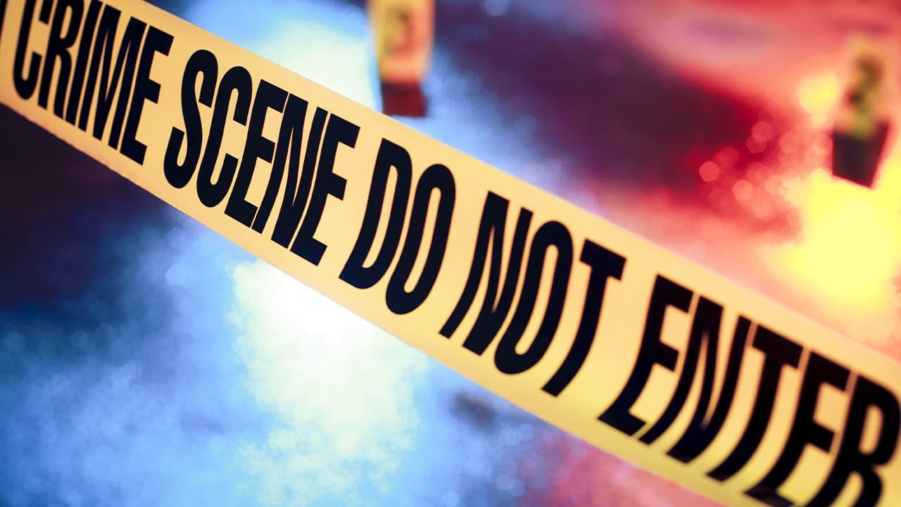 Photo of crime scene tape at night