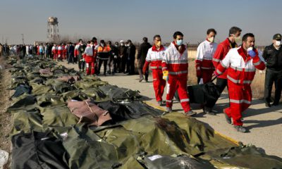 Photo of rescue workers carrying the body of a victim of a Ukrainian plane crash in Shahedshahr