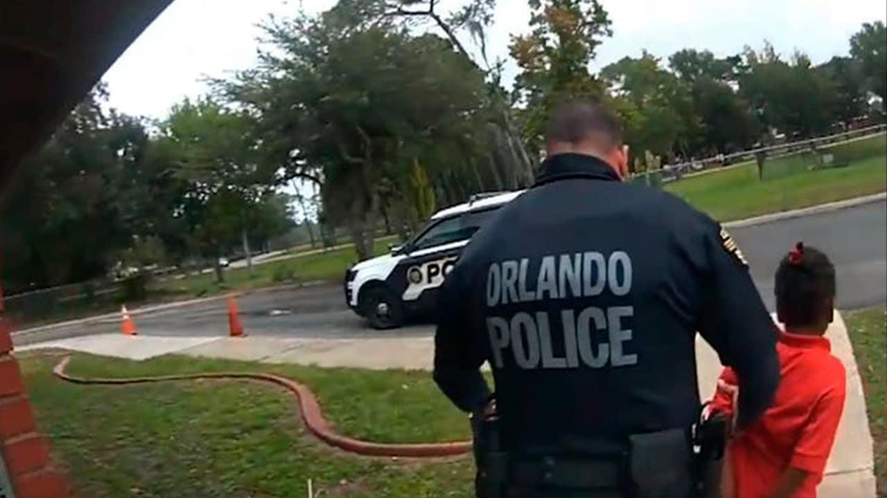 Photo of Orlando police officer Dennis Turner arresting a 6 year old girl