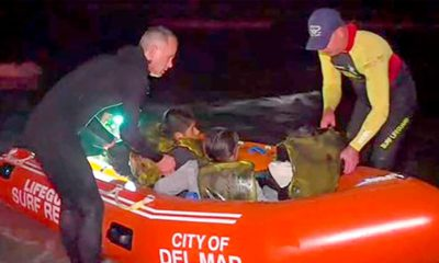 Photo of the rescue of people from an immigrant smuggling boat