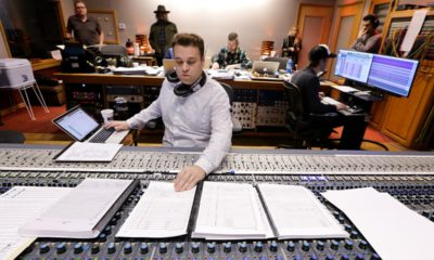 Photo of Nick Spezia working in a control room