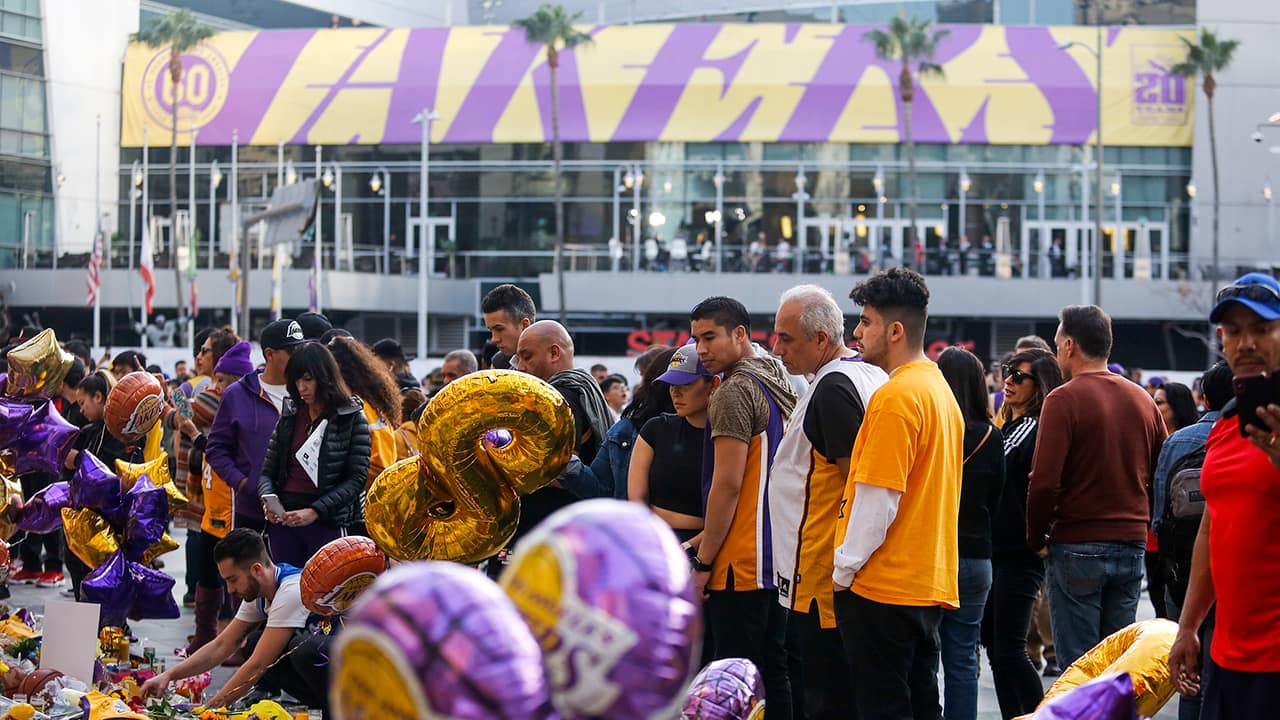 Photo of fans gathering to pay their respects in front of the Staples Center