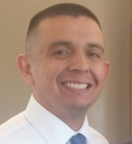 Portrait of Mi Familia Vota's statewide director Samuel Molina