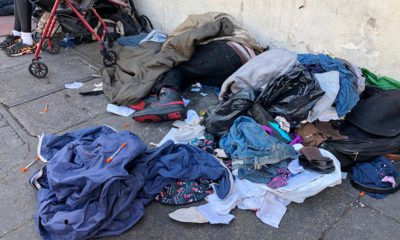 Photo of sleeping people and used needles on the ground in San Francisco