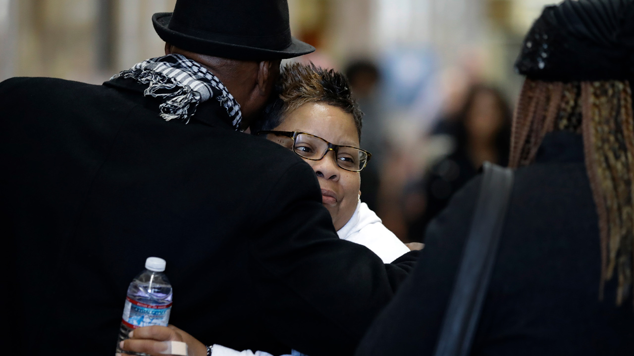 Photo of Alicia Grayson being embraced