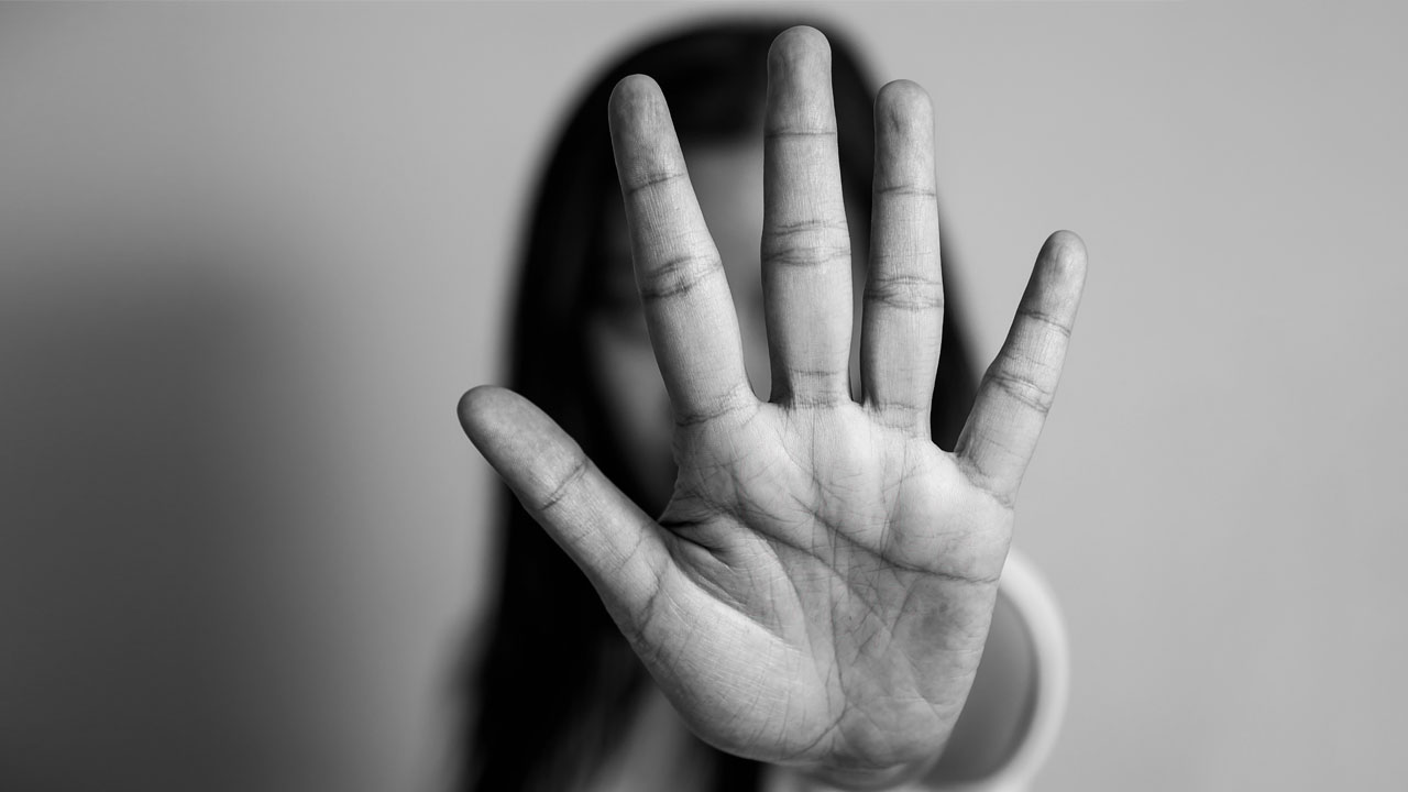 Photo of a girl with her hand to the camera
