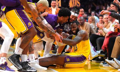 Photo of the Los Angeles Lakers swarming LeBron James