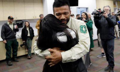 Photo of firefighter Leonard Dimaculangan hugging his daughter