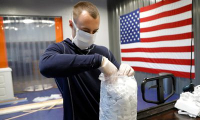 Photo of A.J. Davidson packing face masks