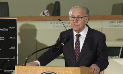 Photo of Fresno Mayor Lee Brand speaking inside City Hall at a podium