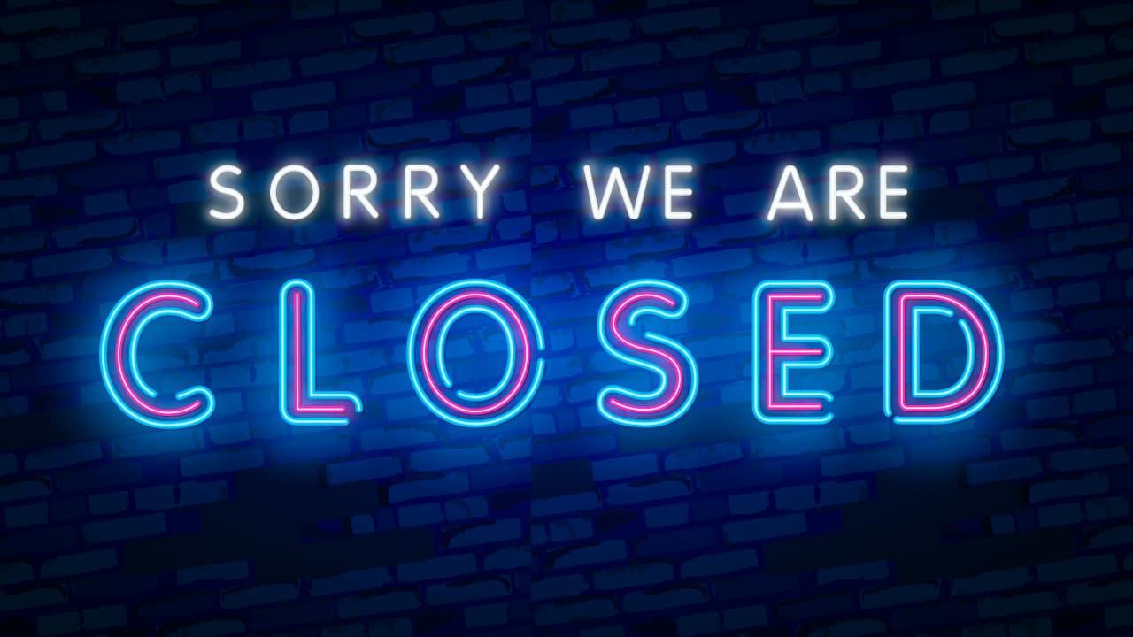 """Neon """"closed"""" sign at a bar"""