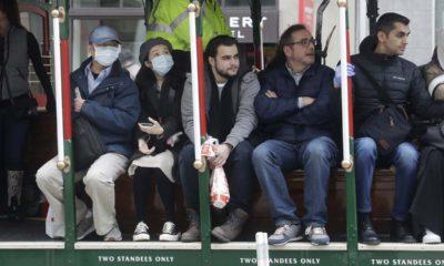 San Francisco cable car riders wearing masks.