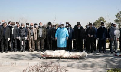 Photo of mourners praying over the body of former politburo official in the Revolutionary Guard Farzad Tazari