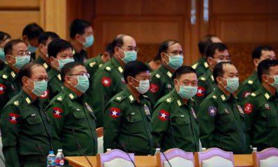 Photo of military representatives wearing masks