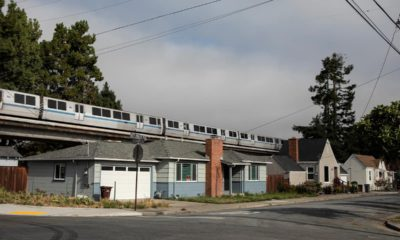 Photo of a BART train running about housing in Albany