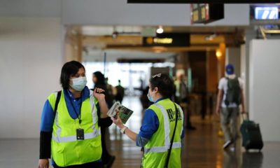 Photo of airport workers waring masks in Washington