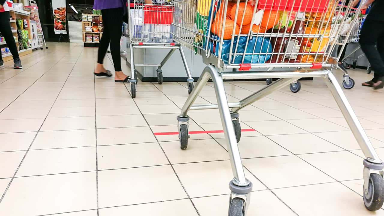 Photo of grocery baskets spaced apart to meet social distancing requirements