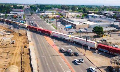 Aerial view of diagonal BNSF train crossing at Blackstone and McKinley avenues in Fresno, California