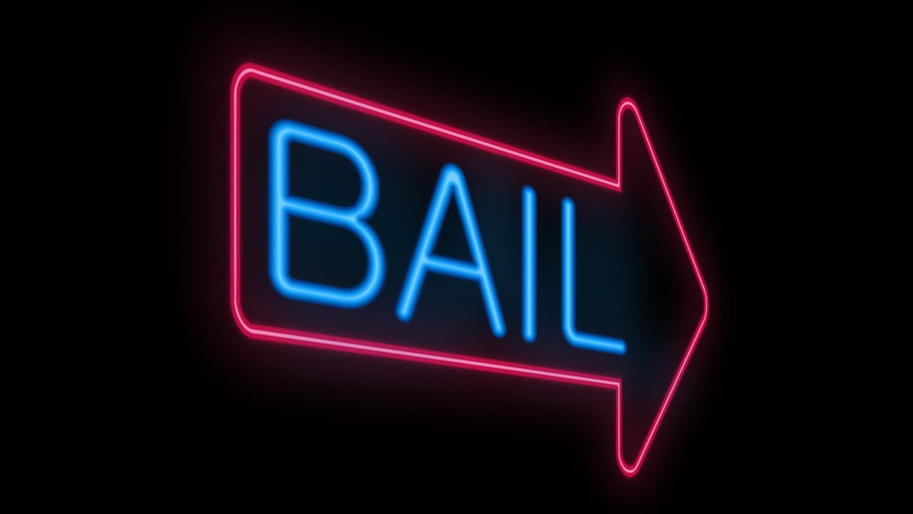 """Photo of a neon """"bail"""" sign"""