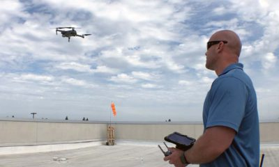 Photo of a drone and its operator