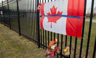 Photo of a Canadian flag at a tribute in Nova Scotia