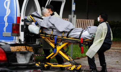 Photo of a patient being taken away from a nursing home