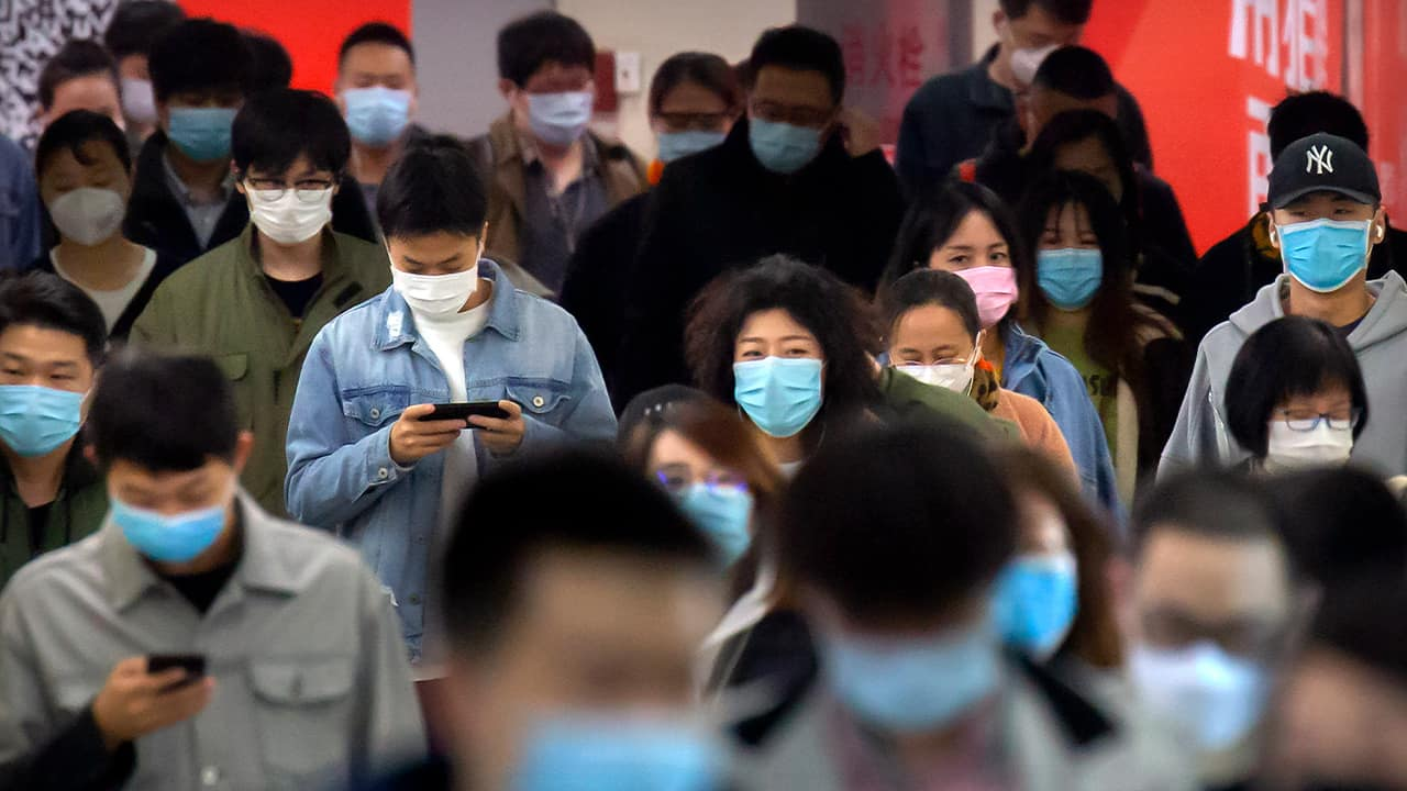 Photo of people wearing face masks in Beijing