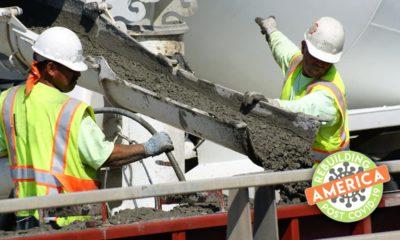 Construction workers pour concretecomposite