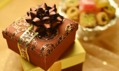 Photos of wrapped gifts and a small food tray for the Eid celebration