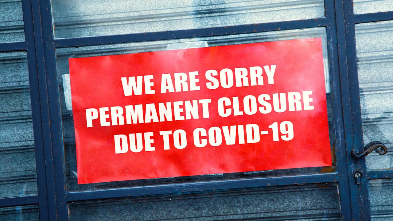 Photo of sign saying permanently closed due to COVID-19