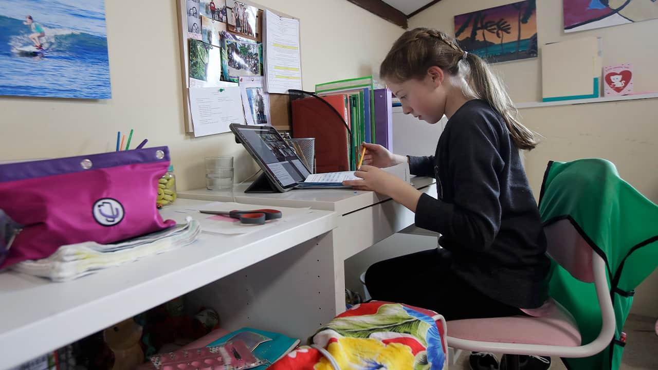Photo of a girl taking an online class