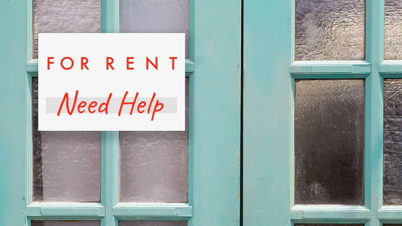 For Rent, Need Help sign on doors of a building
