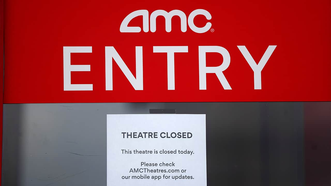 Photo of a closed sign at an AMC Theater