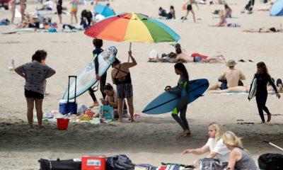 Photo of people at Huntington Beach