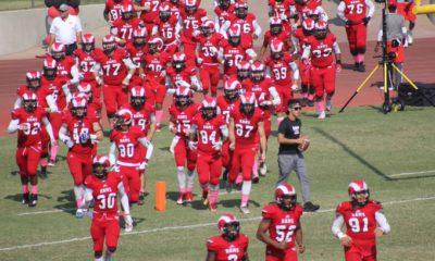 Fresno City College football team runs on to field