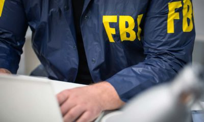 Image of an FBI agent working on a laptop