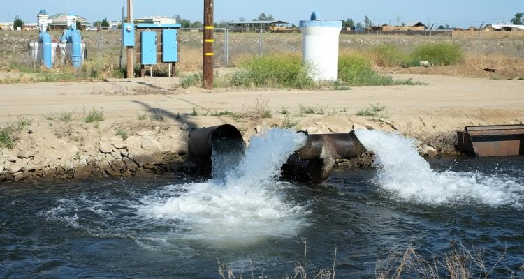 Photo of pumped groundwater flowing into a canal