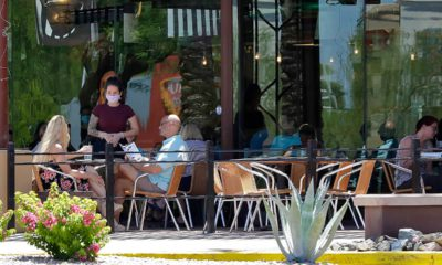 Photo of restaurant guests and mask wearing server in Phoenix, Arizona faguest