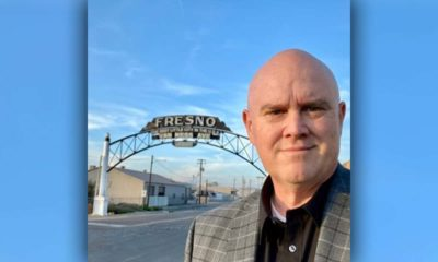 """Image of Bob Nelson in front of the """"Fresno"""" sign downtownRes"""
