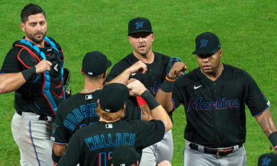 Image of Miami Marlins celebrating a victory in violation of MLB's coronavirus protocols