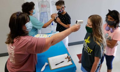 Image of masked students being given temperature checks in Wylie, Texas