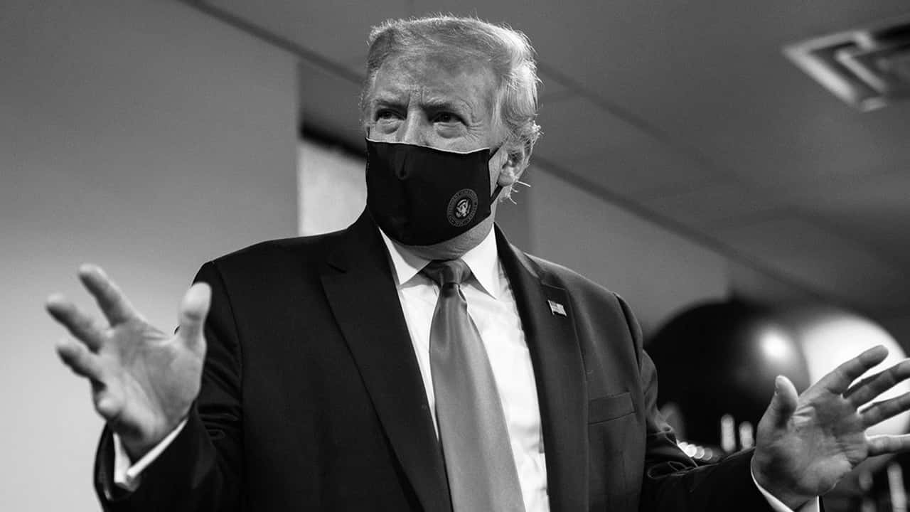 Black and white image of President Donald Trump wearing a mask