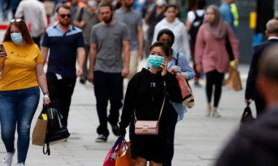 Photo of people wearing masks in London